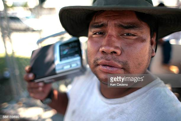 An unidentified Day Laborer listens to the radio outside a Home Depot in San Diego hang out waiting for possible work to come their way on August 28...