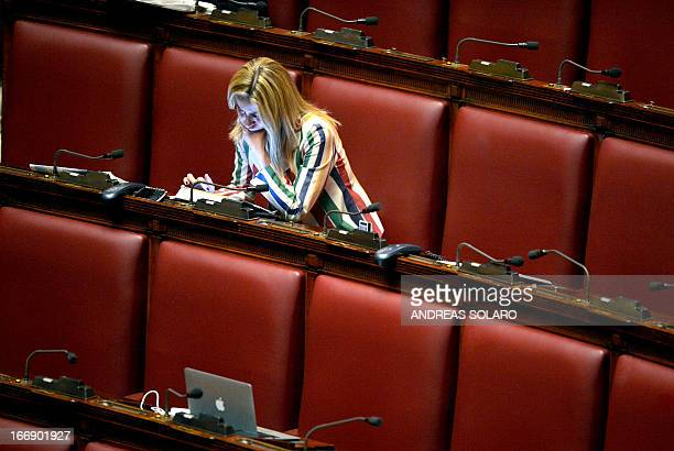 An unidentified deputy follows the vote count on a tablet on April 18 2013 at the Italian parliament in Rome following a second round of voting to...