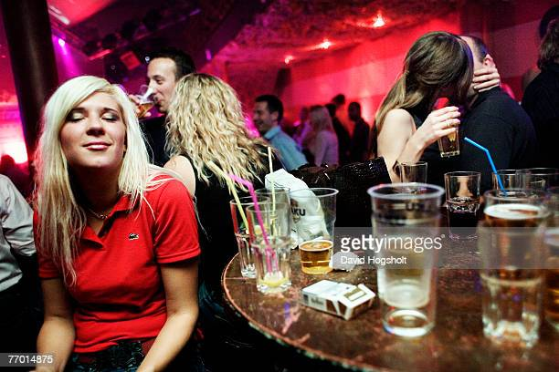 An unidentified Estonian woman taking a break from partying in the night club Hollywood September 15 2006 in Tallinn Estonia Estonia gained...