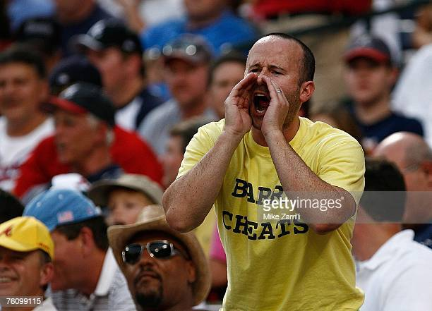 An unidentified fan yells at Barry Bonds with a 'Barry Cheats' tshirt on during the game between the Atlanta Braves and the San Francisco Giants at...