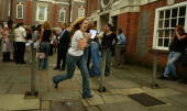 An unidentified girl from The Henrietta Barnett School runs to announce her results to friends after passing her Alevel exams August 19 2004 in...