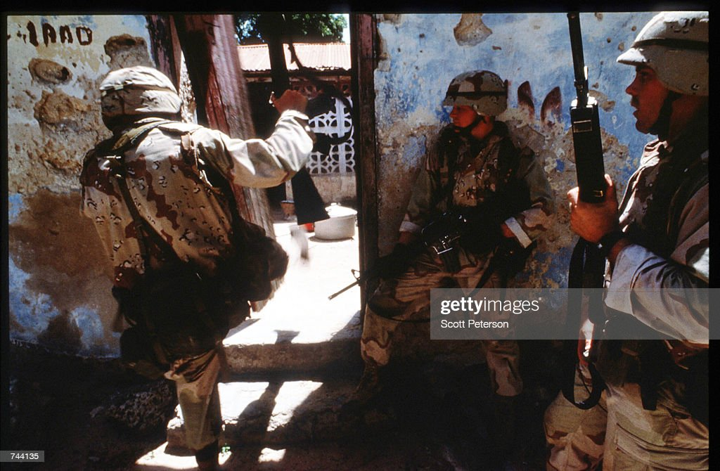 An unidentified group of US soldiers patrol January 11 1993 in Mogadishu Somalia The United Nations hopes to restore order and save hundreds of...