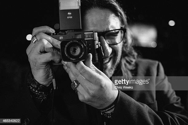 An unidentified guest attends 'Flash' by Lenny Kravitz presented by Leica at Leica Store LA on March 5 2015 in Los Angeles California
