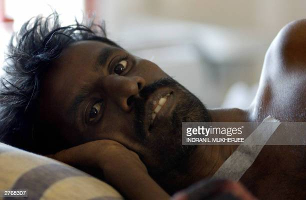 An unidentified Indian HIV positive patient lies on his bed at the Freedom Foundation HIV/AIDS care and support facility on the outskirts of...