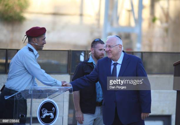 An unidentified Israeli officer shakes hands with President of Israel Reuven Rivlin during an event at the Wailing Wall held to commemorate the 50th...