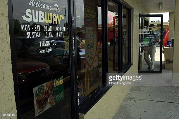 An unidentified man enters a Subway restaurant March 26 2003 in Tampa Florida Tampa police were called to this store after an employee and customer...