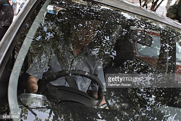 An unidentified man leaves the North Korean Embassy compound in his car on February 22 2017 in Kuala Lumpur Malaysia North Korean leader Kim Jong...