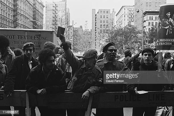 An unidentified man raises his arm in defiance at a protests against the incarceration of members of the Black Panthers New York New York November 17...