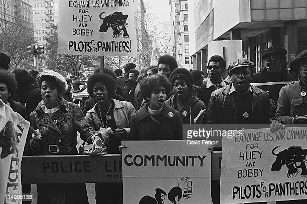 An unidentified man raises his fist in defiance at a protests against the incarceration of members of the Black Panthers New York New York November...