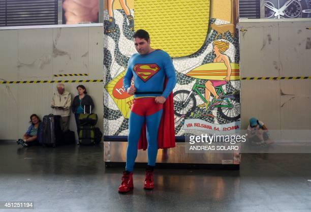 An unidentified man wearing a costume of Superman poses at Rome's Stazione Termini railway station on June 26 2014 AFP PHOTO / ANDREAS SOLARO