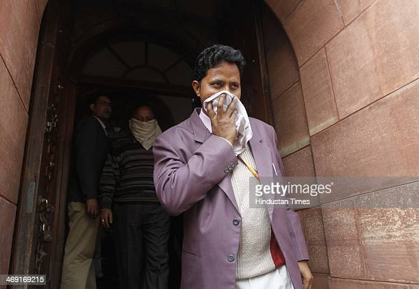An unidentified member of Parliament covers his face with a handkerchief after being affected by pepper spray gas parliament session erupted in chaos...
