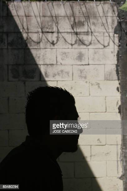 An unidentified member of the Mara Salvatrucha juvenile gang stands in the unit where he is kept imprisioned for homicide in the prison of...