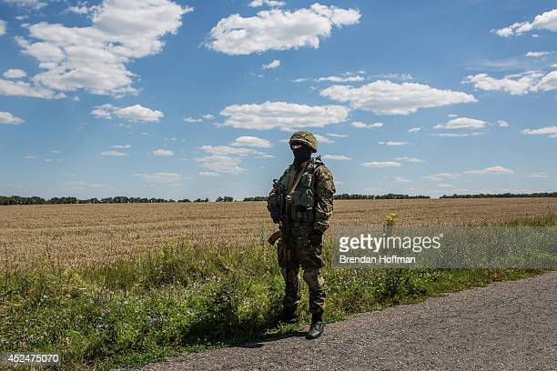An unidentified member of the security detail for inspectors from the Organization for Security and Cooperation in Europe and the Dutch government...