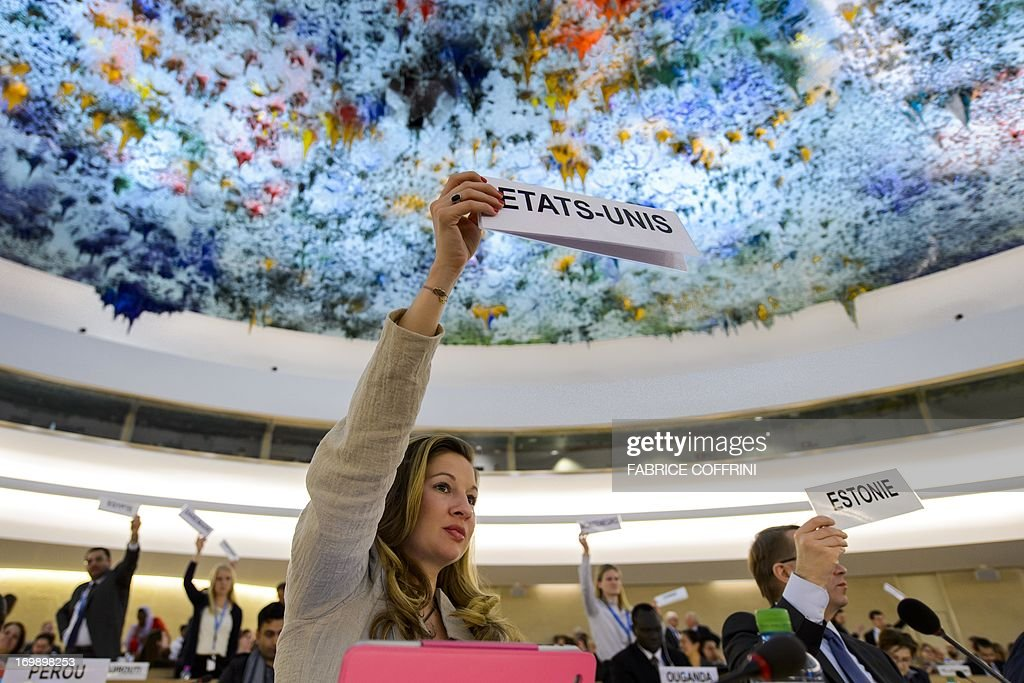 An unidentified member of the US delegation raises a placard requesting the floor for the delegation after the report of the United Nations Independent Commission of Inquiry (CoI) on Syria on June 4, 2013 before the UN Human Rights Council Geneva. UN investigators said on June 4 they had 'reasonable grounds' to believe chemical weapons have been used by both sides in Syria, and warned that crimes against humanity are now occurring daily in the war-torn country.