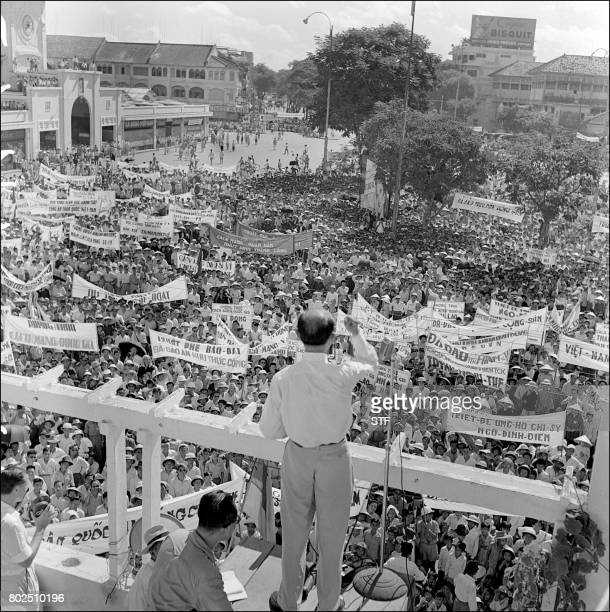 An unidentified member of the Vietnamese National Popular Council speaks to protesters demonstrating in support of the policy of Premier general Ngo...