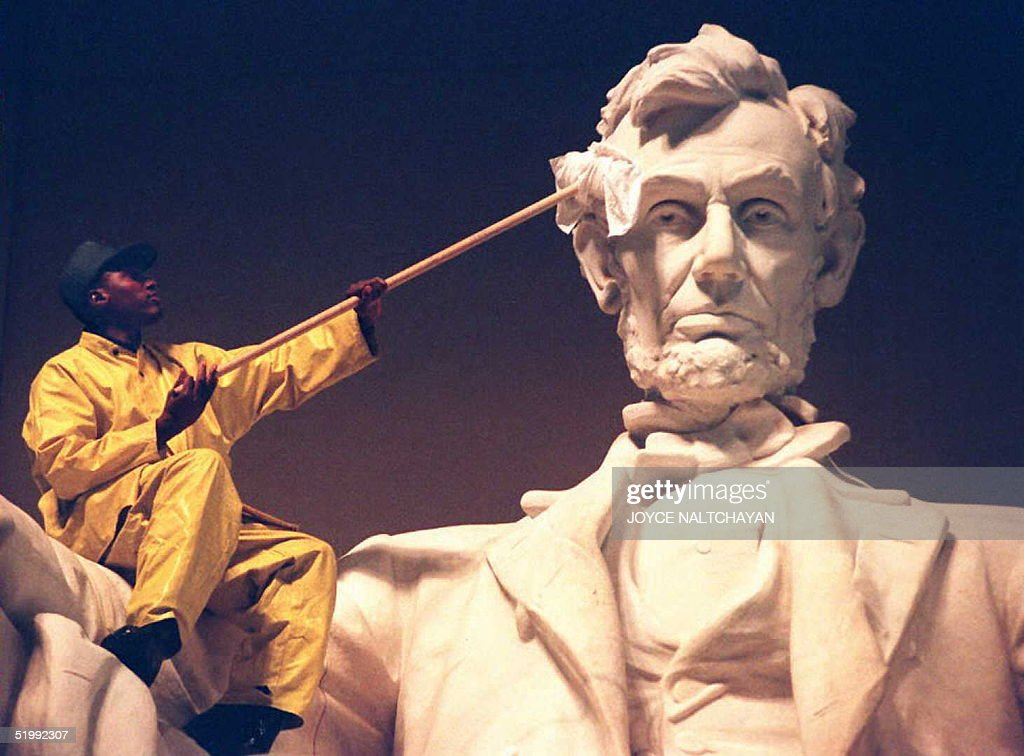 An unidentified National Park Service worker cleans the statue of Abraham Lincoln 25 October as part of the annual cleaning of the Lincoln Memorial on the National Mall in Washington DC.