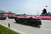An unidentified North Korean missile is displayed during a military parade past Kim IlSung square marking the 60th anniversary of the Korean war...