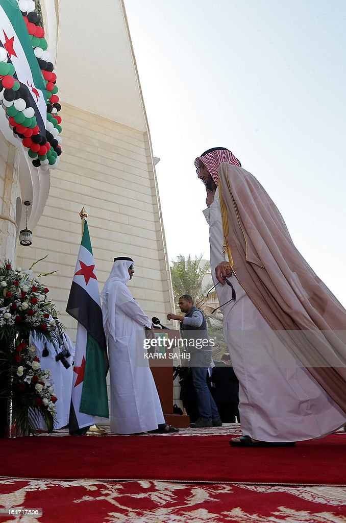An unidentified official attends the inauguration of the first Syrian interim government embassy to open in Qatar, in the capital Doha on March 27, 2013.