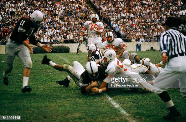 An unidentified player of the ranked Texas AM Aggies is tackled by a group of players from the Maryland Terrapins during the game on September 21...