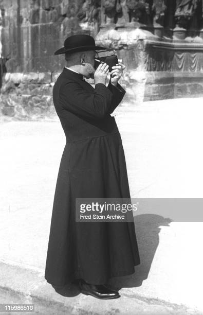 An unidentified priest films with a Super 8 movie camera Paris France 1937