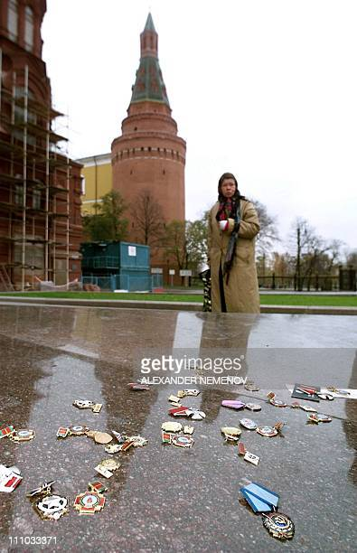 An unidentified relative of one of about 100 protesting people who participated in the cleanup operations after the 1986 Chernobyl nuclear disaster...