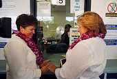 An unidentified same sex couple waits to get a marriage license at the Los Angeles county clerk office in Norkwalk California After the United States...