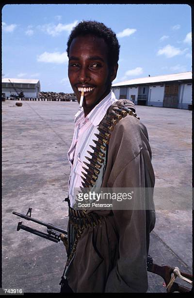 An unidentified Somali gunmean smiles for the camera November 23 1992 in Kismayo Somalia They are part of the Somali Patriotic Movement ruled by...