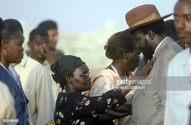 An unidentified Sudanese woman welcomes Salva Kiir successor to the late southern Sudanese leader John Garang upon his arrival 10 August 2005 at...