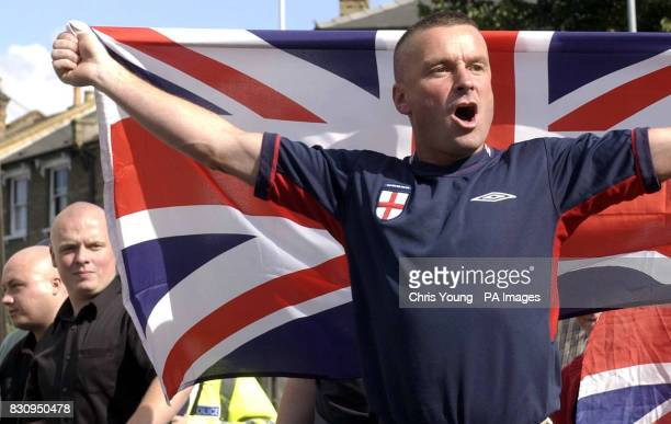 An unidentified supporters of the far right group the National Front march past the Finsbury Park Mosque in north London The Mosque has been...