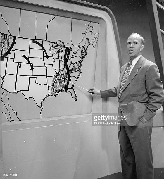 An unidentified weather forecaster uses a pointer to highlight a rain system on the Gulf Coast during a broadcast of 'The Morning Show' New York New...