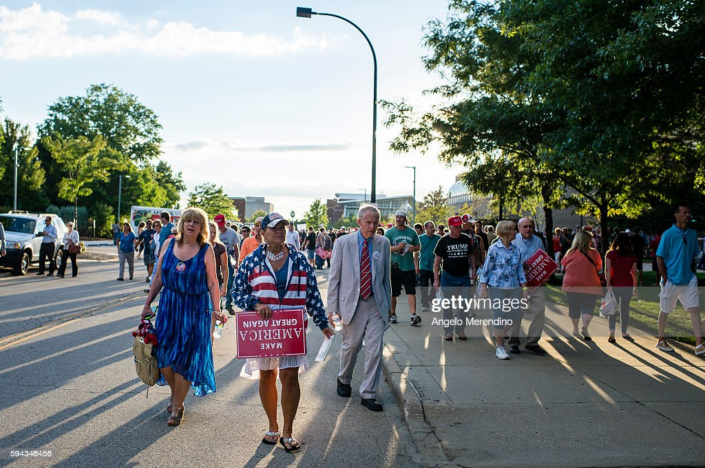 An unidentified woman carries an upside down sign after Republican Presidential candidate Donald Trump spoke to supporters at the James A Rhodes...