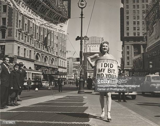 An unidentified woman dressed in high heels and a wooden barrel that reads 'I did my bit did you' walks in Times Square to advertises a nationwide...