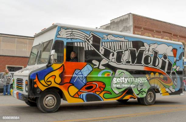 An unidentified woman drives an Art Mobile truck as part of the annual Saint Patrick's Day Parade Emporia Kansas March 11 2017