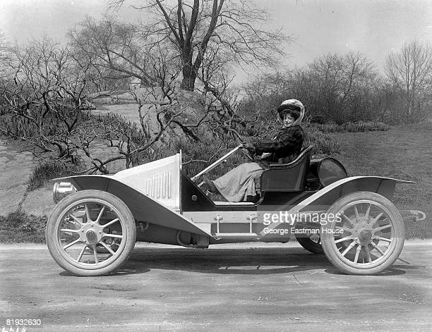 An unidentified woman enjoys some time outdoors while driving on quiet roads ca1900s United States