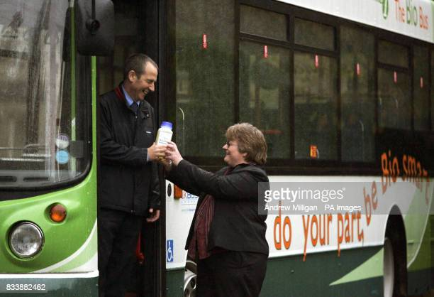 An unidentified woman hands a container of cooking oil to the driver in return for a discounted bus fares as Stagecoach launches the UK's first...