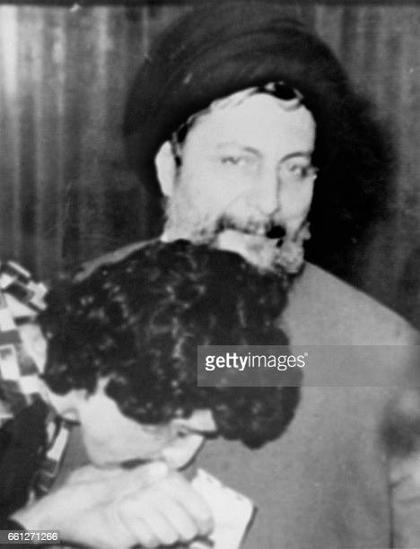 An unidentified woman kisses the hand of Musa Sadr the Lebanese Shiite Moslem cleric who founded the Amal movement before vanishing in 1978 Sadr's...