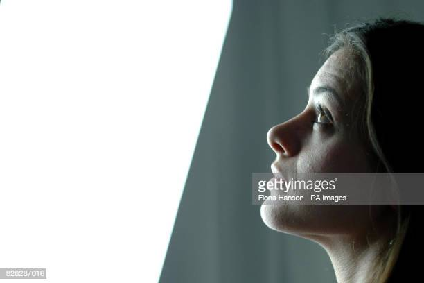An unidentified woman looks at a ' light lounge' Monday January 9 a free treatment aimed at Seasonal Affective Disorder sufferers a form of...