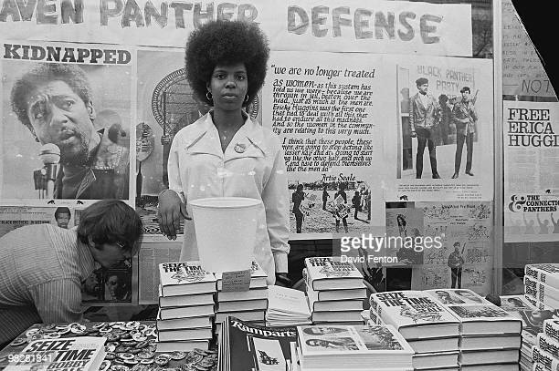 An unidentified woman stands in front of a table at the Black Panther Party headquarters in New Haven selling copies of Ramparts magazine and Bobby...