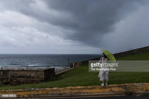 An unidentified women stares to the sea in front the iconic El Morro Fortress in Old San Juan San Juan September 19 2017
