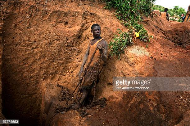 An unidentified young man works in a cobalt mine on December 13 2005 in Ruashi mine about 20 kilometers outside Lubumbashi Congo DRC Children as...