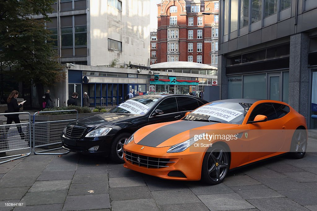 An uninsured fluorescent orange Ferrari FF worth over 200,000 GBP which has been seized by police on display outside New Scotland Yard on September 27, 2012 in London, England. The illegal vehicle was taken by police working on 'Operation Cubo' from its 28-year-old owner in South Kensington earlier this month, they are yet to claim it back.
