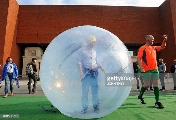 An unionist stands inside an inflatable plastic bubble prior to a symbolic football match between unionists and human rights activists to denounce...