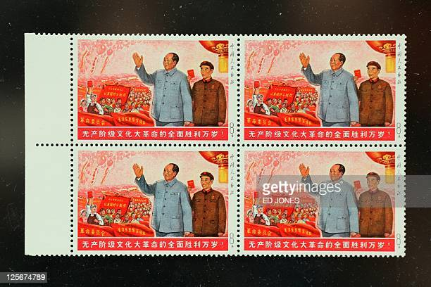 "An unissued 1968 ""Great Victory of the Cultural Revolution"" stamp is displayed during a preview ahead of the selftitled 'largest ever' auction of..."