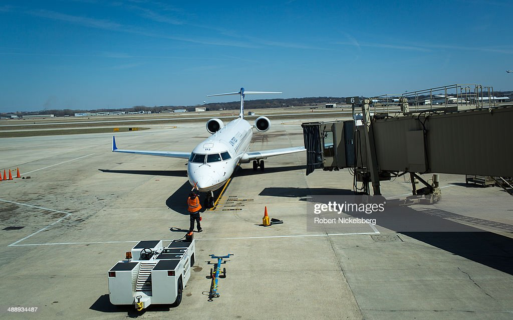 An United Express plane arrives at a docking bay April 18, 2014 at the Madison, Wisconsin airport. United Express is the regional branch of United Airline comprising eleven individually owned regional airlines flying short to medium distance routes.