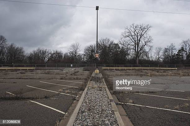 An unkempt parking lot is seen in the former site of the General Motors Co powertrain plant inside the Willow Run airport in Ypsilanti Michigan US on...