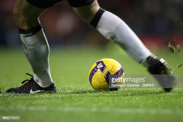 An unknow footballer with Nike boots kicks a Nike matchball