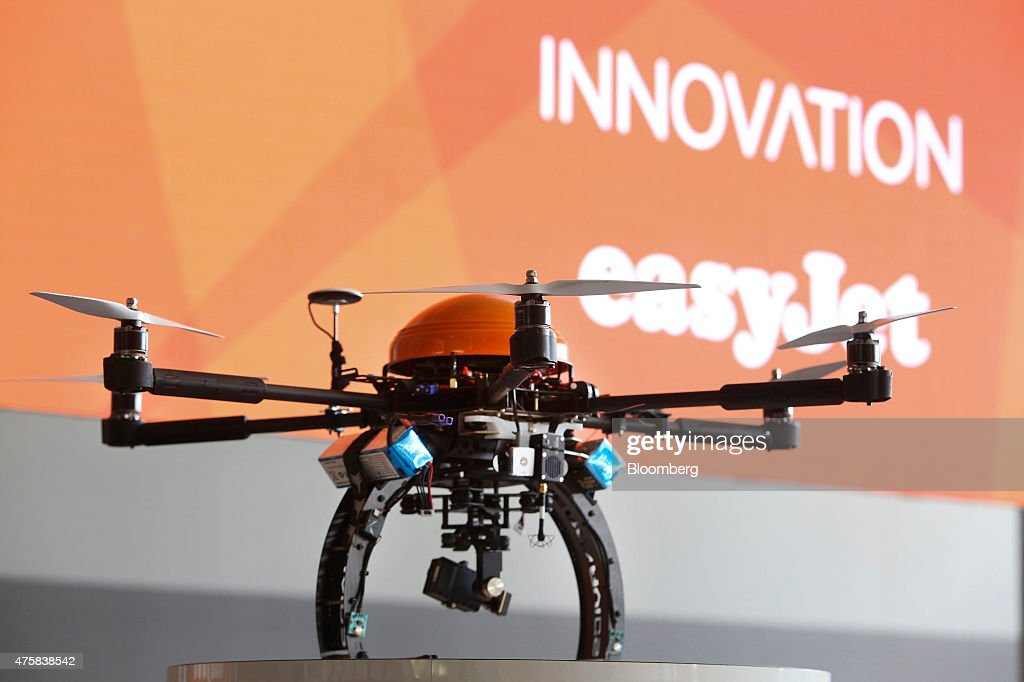 An unmanned drone, used by Easyjet Plc to inspect an aircraft during maintenance, sits on display during the 'Easyjet Plc Innovation Event' held at Milan's Malpensa airport in Milan, Italy, on Thursday, June 4, 2015. EasyJet Plc said it will begin using drones to inspect jets on the ground starting next year and is experimenting with the 3-D printing of replacement parts as it pursues innovations to keep costs down. Photographer: Chris Ratcliffe/Bloomberg via Getty Images