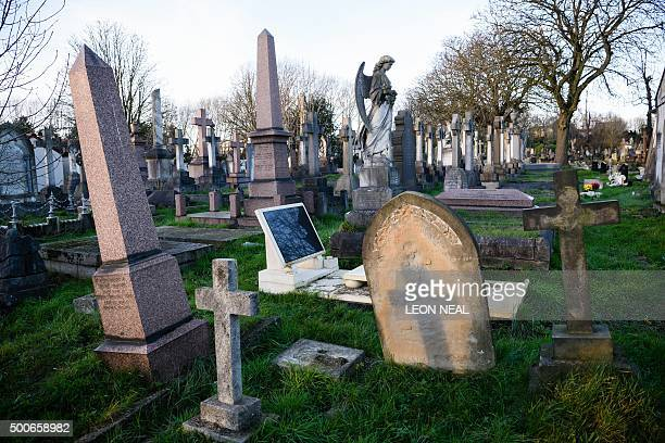 An unmarked grave with a headstone that resembles a computer screen nicknamed 'iGrave' by the Cemetery Club is seen in Kensal Green cemetery...