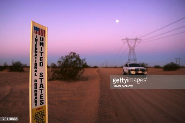 An unmarked US Customs and Border Protection border patrol vehicle drives along USMexico border where no fence divides the US from Mexico before dawn...