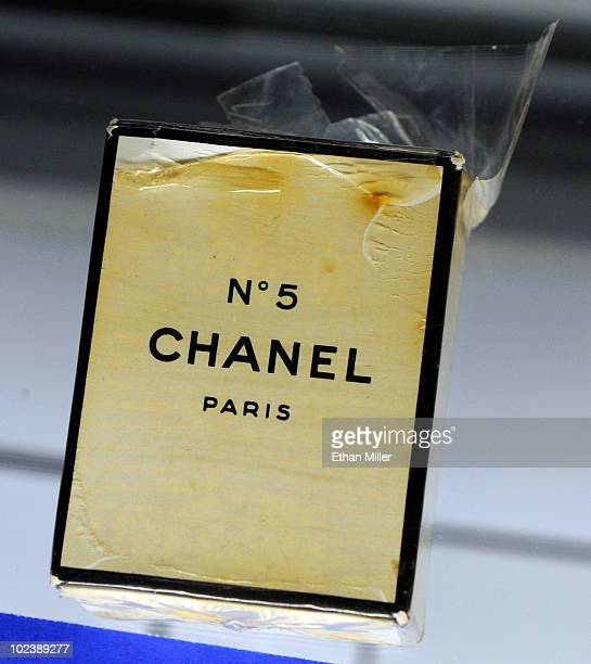 An unopened bottle of Chanel No 5 perfume in its original plastic wrap and box owned by Marilyn Monroe is displayed at Julien's Auctions annual...